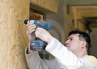 Drilling wooden wall