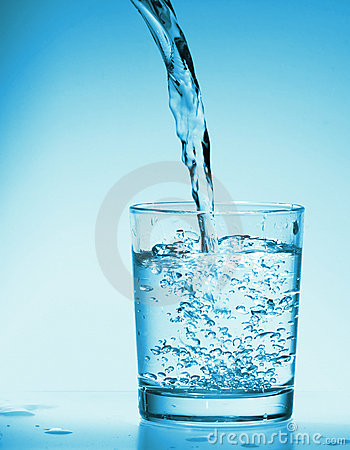 Drink Water poring into a  glass