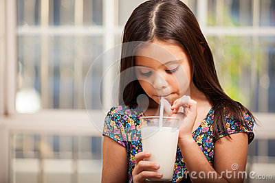 Drinking milk with a straw