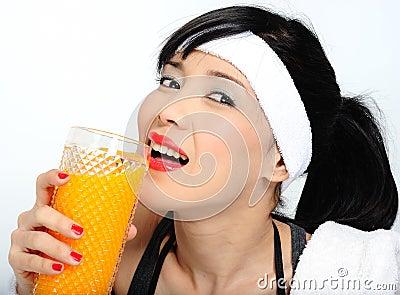 Drinking orange juice  after practicing sport