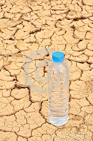 Drinking water bottle on arid background