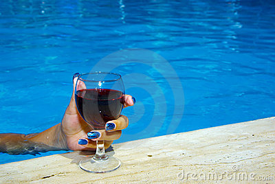 Drinking wine in the pool