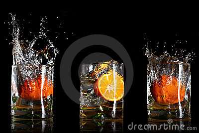 Drinks with splashing oranges