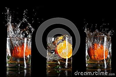 Drinks with splashing oranges