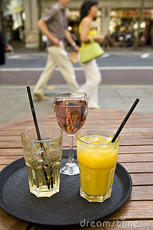 Drinks on tray in outdoor city bar