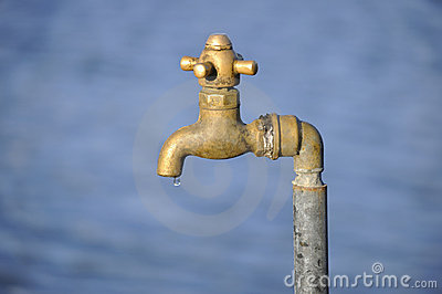 Dripping brass tap