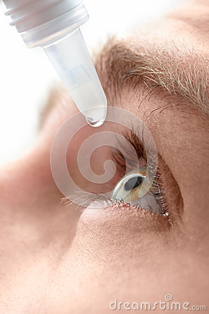 Free Dripping Eye With Eyes Drops Stock Image - 25541171