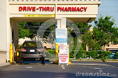 Drive thru pharmacy with a vehicle at the pickup window
