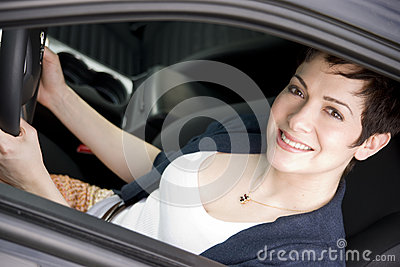 Female Driver Seated in Black Sport Sedan Auto