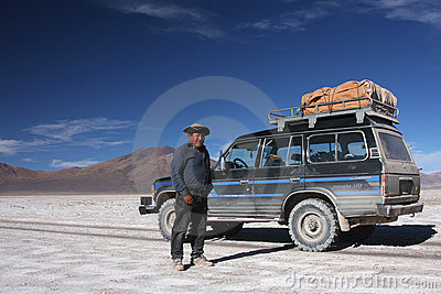 Driver and his car on the salar Editorial Photo