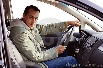 Driver in his new car