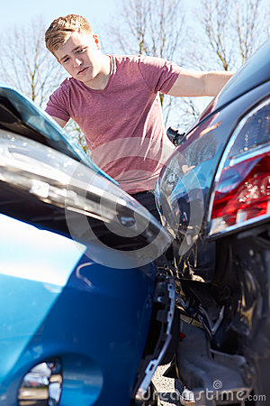 Driver Inspecting Damage After Traffic Accident