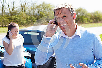 Driver Making Phone Call After Traffic Accident