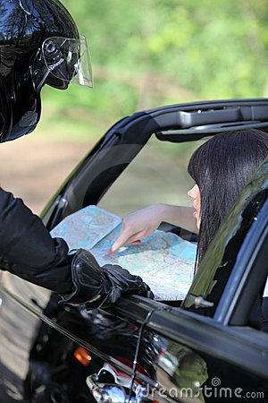 Driver reading a road map
