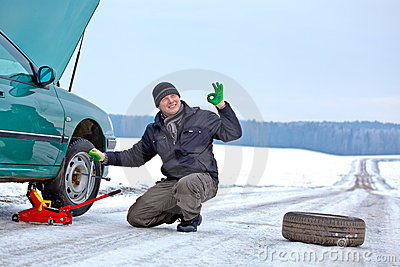 Driver repairing car at the road