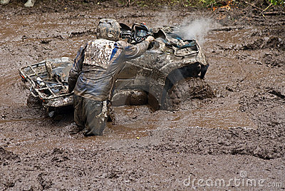 Driver and vehicle in mud