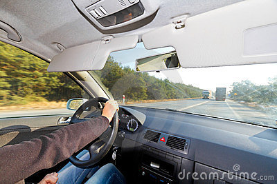 Driving a car in sunny weather