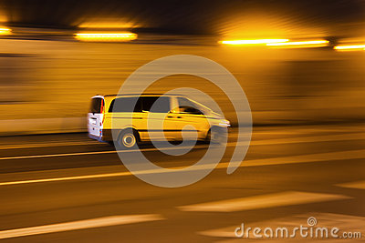 Driving car in a tunnel in motion blur