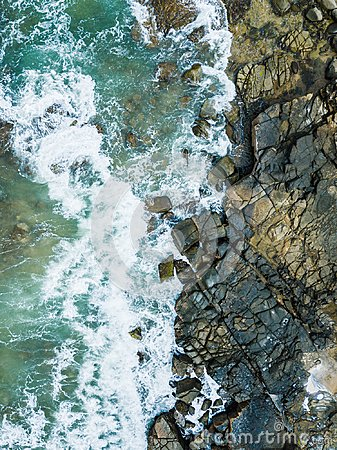 Free Drone Beach Aerial Photo Of Water And Rocks. Royalty Free Stock Images - 107723049