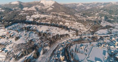 Aerial view of a mountain village. Winter landscape. Drone footage snow covered trees, winter nature. Carpathian Mountains, Ukrain. Drone footage snow covered stock footage