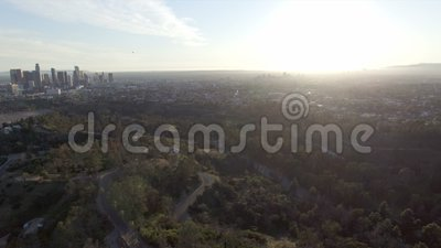 Aerial view rising high above Los Angeles at sunset stock footage