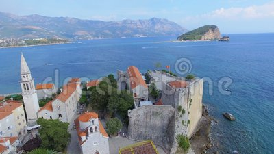 Aerial View Of Budva Old Town Beach and St. Nicholas island, Montenegro 2. Drone Shot Of Budva Old Town Beach and St. Nicholas island, Montenegro 2 stock footage