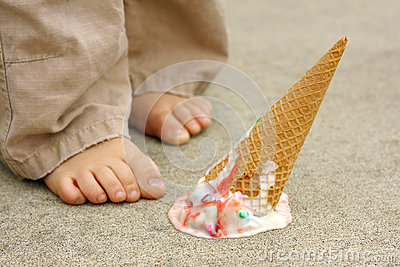 Dropped Ice Cream Cone by Child s Feet