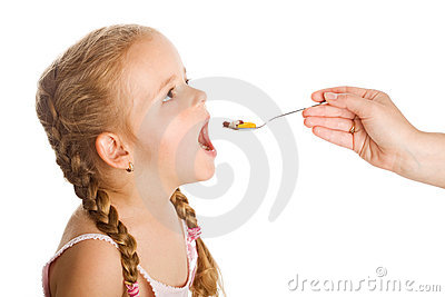 Drug abuse - little girl taking pills with spoon