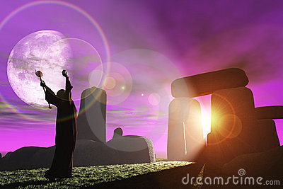 Druid greets the dawn at Stonehenge