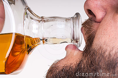 Drunk businessman drinking