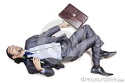 Drunk businessman on floor