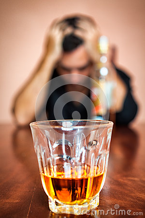 Drunk and depressed man addicted to alcohol