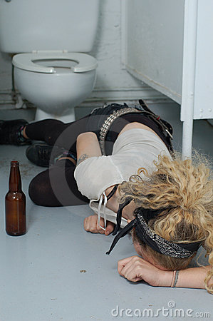 Free Drunk Girl In A Public Toilet 5 (focus On Head & Left Hand) Stock Photography - 1574202