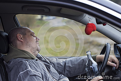 Drunk man asleep in car