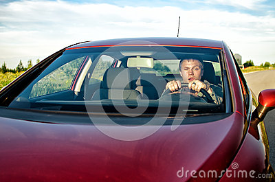 Drunk man in a car