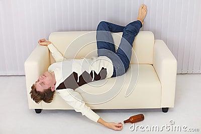 Drunk person funny sleeps on sofa