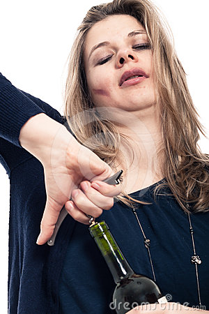 Drunk woman opening bottle of alcohol