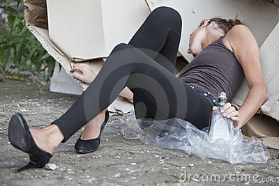 Drunk woman sleeping in cartons