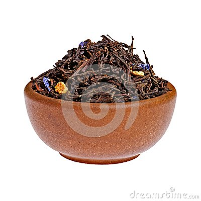Dry black tea in a clay cup from above