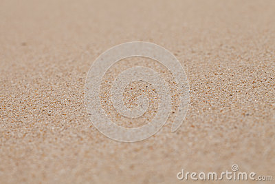 Dry clean sand background with narrow focus