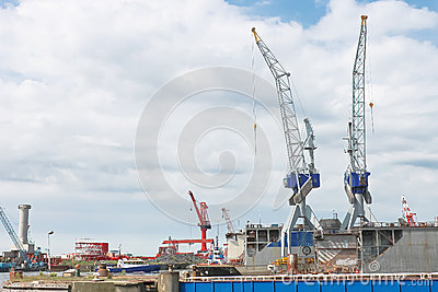 Dry docks and cranes in shipyard
