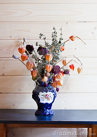 Dry flowers in a dark blue vase