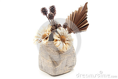 Dry flowers in stone vase