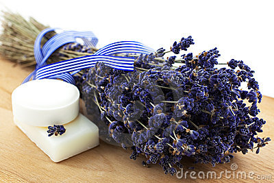 Dry lavender bunch with two white soap pieces