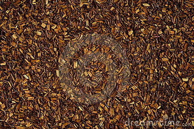Dry loose Rooibos red tea, texture, background