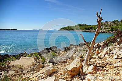 Dry rocky land on the coast of the turquoise sea