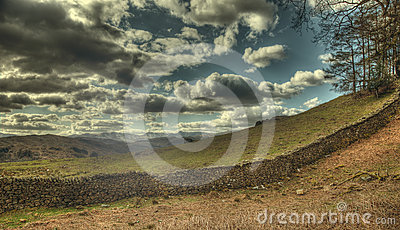 Dry stone wall and clouds