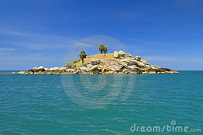 Dry uninhabited island and blue sky