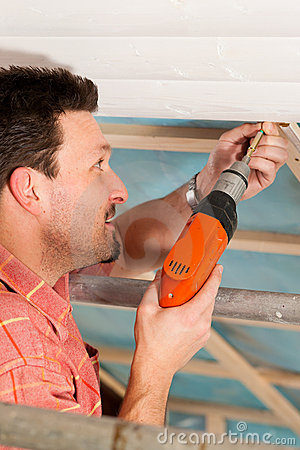 Free Dry Waller With Cordless Screwdriver Royalty Free Stock Photos - 20445908