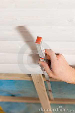 Free Dry Waller With Measuring With Folding Rule Stock Photo - 20445770